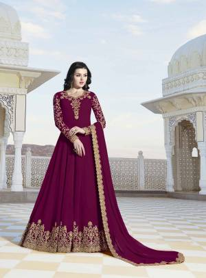 Shine Bright Wearing This Designer Floor Length Suit In Magenta Pink Color Paired With Magenta Pink Colored Bottom And Dupatta, Its Top And Dupatta Are Fabricated On Georgette Paired With Santoon Fabricated Bottom .