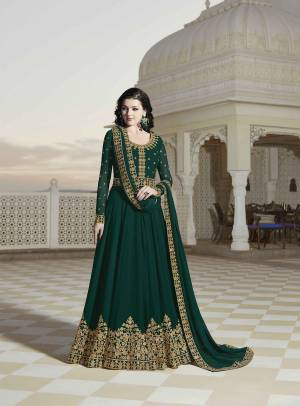 Celebrate This Festive And Wedding Season With Beauty And Comfort Wearing This Designer Floor Length Suit In Dark Green Color Paired With Dark Green Colored Bottom And Dupatta. Its Heavy Embroidered Top And Dupatta Are Georgette Based Paired With Santoon Fabricated Bottom.