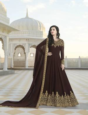 EnhanceYour Personality Wearing This Designer Floor Length Suit In Brown Color Paired With Brown Colored Bottom And Dupatta. Its Top And Dupatta Are Georgette Based Paired With Santoon Fabricated Bottom.
