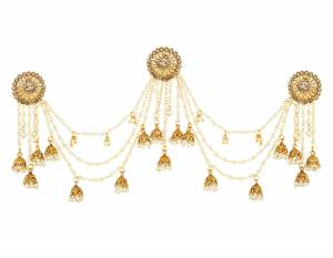 For A Bun Hair Style, Grab This Single Earring In Golden Color Beautified With Stone And Pearl Chains. This Earring Is Tucked Over The Hair Which Looks Great With Bun Hairdo