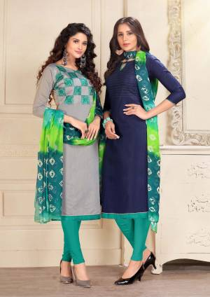 Here Is An elegant Looking Pair In Dress Material With Two Tops. Its Grey Top Is Fabricated On Cotton And Navy Blue Is Chanderi Based Paired With Turquoise Blue Colored Cotton Bottom And Chiffon Dupatta. Buy Now.