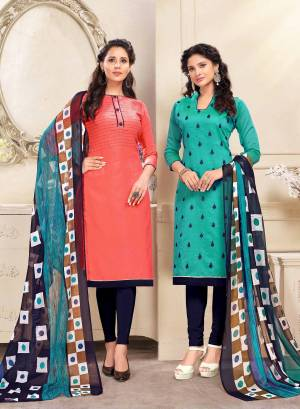 Beautiful Combiantion Is Here With This Dress Material With Two Tops. Its Orange Colored Top Is Cotton Based And Turquoise Blue One Is Chanderi Fabricated Paired With Navy Blue Colored Bottom And Dupatta. Its Attractive Color And Elegant Design Will Earn You Lots Of Compliments From Onlookers.
