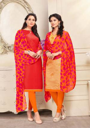 Here Is An elegant Looking Pair In Dress Material With Two Tops. Its Red Top Is Fabricated On Cotton And Beige Is Chanderi Based Paired With Orange Colored Cotton Bottom And Orange And Pink Chiffon Dupatta. Buy Now.