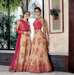 Grab This Designer Two-In-One Lehenga Choli For The Upcoming Festive And Wedding Season. Its Blouse Is Fabricated On Art Silk And Net Paired With Printed Modal Silk And Net Fabricated Dupatta. It Is Beautified With Bold Floral Prints And Attractive Embroidery. Buy Now.