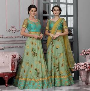 As Per Your Convinince And Occasion, Get This Two-In-One Dress Stitched As Lehenga Or Suit. Its Pretty Blouse Is Fabricated On Art Silk And Net Paired with Modal Silk Fabricated Lehenga And Net Fabricated Dupatta. It Is Beautified With Bold Floral Prints With Embroidery. Also Its Fabrics Ensures Superb Comfort All Day Long.