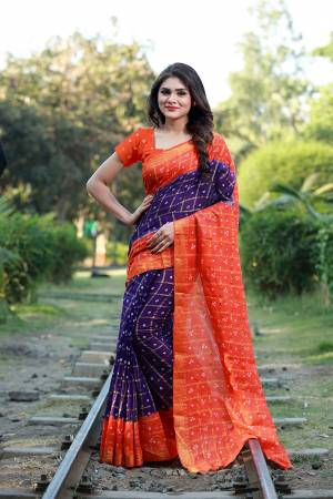 This Festive Season Be The Most Unique Of All Wearing This Handicraft Bandhani Saree. This pretty Saree And Blouse Are Fabricated On Tafeta Art Silk Which Also Gives A Rich Look To Your Personality.