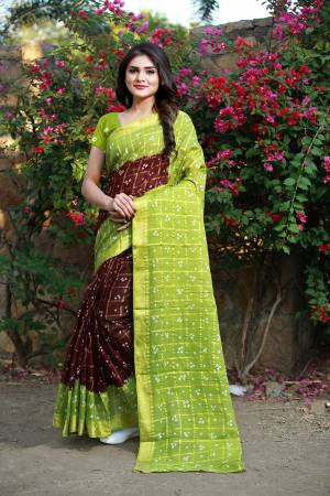 For A Rich And Elegant Look, Grab This Designer Saree With Handicarft Bandhani Print. This Saree And Blouse Are Fabricated On Tafeta Art Silk Which Is Light In Weight And Easy Ro Carry All Day Long.