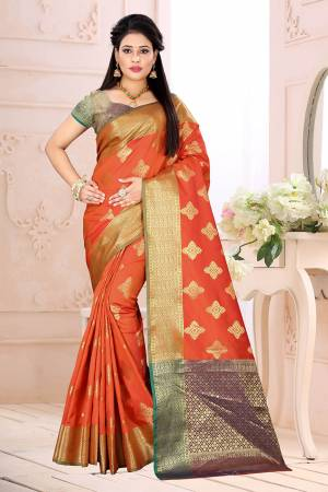 Celebrate This Festive Season Wearing This Saree In Orange Color Paired With Contrsating Purple Colored Blouse. This Saree Is Fabricated On Cotton Silk Paired With Jacquard Silk Fabricated Blouse. It Is Beautified With Weave All Over.