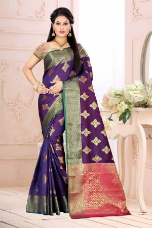 Celebrate This Festive Season Wearing This Saree In Violet Color Paired With Contrsating Pink Colored Blouse. This Saree Is Fabricated On Cotton Silk Paired With Jacquard Silk Fabricated Blouse. It Is Beautified With Weave All Over.