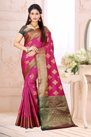 Celebrate This Festive Season Wearing This Saree In Rani Pink Color Paired With Contrsating Purple Colored Blouse. This Saree Is Fabricated On Cotton Silk Paired With Jacquard Silk Fabricated Blouse. It Is Beautified With Weave All Over.