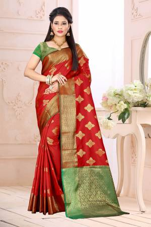 Celebrate This Festive Season Wearing This Saree In Red Color Paired With Contrsating Green Colored Blouse. This Saree Is Fabricated On Cotton Silk Paired With Jacquard Silk Fabricated Blouse. It Is Beautified With Weave All Over.