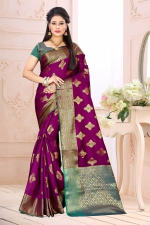 Celebrate This Festive Season Wearing This Saree In Magenta Pink Color Paired With Contrsating Blue Colored Blouse. This Saree Is Fabricated On Cotton Silk Paired With Jacquard Silk Fabricated Blouse. It Is Beautified With Weave All Over.