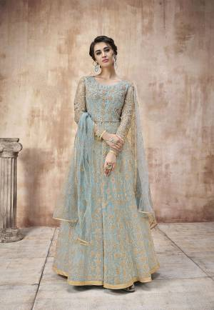 Summers Is About Subtle Shades And Pastel Play, So Grab This Designer Floor Length Suit In Light Blue Color Paired With Light Blue Colored Bottom And Dupatta. Its Heavy Embroidered Top Is Net Based Paired With Satin Silk Bottom And Net Fabricated Dupatta. Buy This Semi-Stitched Suit Now.