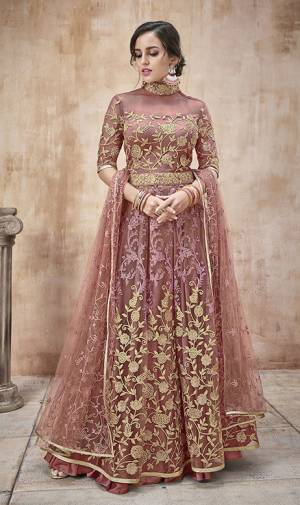 Add This New Shade In Pink To Your Wardrobe With This Designer Floor Length Suit In Onion Pink Color. Its Heavy Embroidered Top And Dupatta Are Net Based Paired With Satin Silk Bottom. Buy Now.