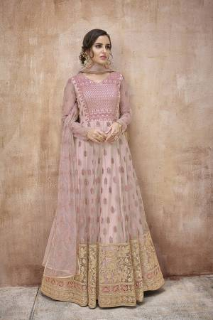 Look Pretty In This Pretty Designer Floor Length Suit In Baby Pink Color Paired With Baby Pink Colored Bottom And Dupatta. Its Top And Dupatta are Fabricated On Net Paired With Satin Silk Bottom. Its Fabrics Ensures Superb Comfort Throughout The Gala.