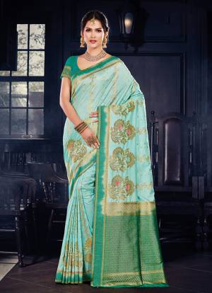 For A Rich And Elegant Look In Traditionals. Grab This Designer Silk Based Saree Paired With art Silk Fabricated Blouse. It Is Beautified With Heavy Weave all Over, And Its  Fabric And Color Pallete Gives A Rich Look To Your Personality.