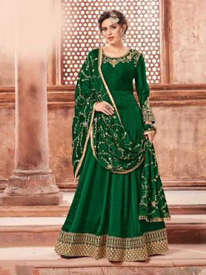 You Will Definitely Earn Lots Of Compliments Weairng This Designer Floor Length Suit In Dark Green Color Paired With Dark Green Colored Bottom And Dupatta. Its Top Is Fabricated On Satin Georgette Paired With Santoon Bottom And Heavy Embroidered Chinon Dupatta. The Main Highlight In This Designer Suit Is Its Embroidered Dupatta. Buy This Semi-Stitched Suit Now.