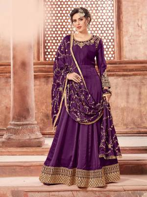 You Will Definitely Earn Lots Of Compliments Weairng This Designer Floor Length Suit In Purple Color Paired With Purple Colored Bottom And Dupatta. Its Top Is Fabricated On Satin Georgette Paired With Santoon Bottom And Heavy Embroidered Chinon Dupatta. The Main Highlight In This Designer Suit Is Its Embroidered Dupatta. Buy This Semi-Stitched Suit Now.