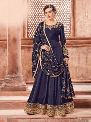 You Will Definitely Earn Lots Of Compliments Weairng This Designer Floor Length Suit In Navy Blue Color Paired With Navy Blue Colored Bottom And Dupatta. Its Top Is Fabricated On Satin Georgette Paired With Santoon Bottom And Heavy Embroidered Chinon Dupatta. The Main Highlight In This Designer Suit Is Its Embroidered Dupatta. Buy This Semi-Stitched Suit Now.