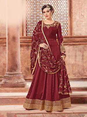 You Will Definitely Earn Lots Of Compliments Weairng This Designer Floor Length Suit In Maroon Color Paired With Maroon Colored Bottom And Dupatta. Its Top Is Fabricated On Satin Georgette Paired With Santoon Bottom And Heavy Embroidered Chinon Dupatta. The Main Highlight In This Designer Suit Is Its Embroidered Dupatta. Buy This Semi-Stitched Suit Now.