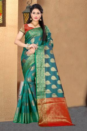 Add This Beautiful Silk Based Saree To Your Wardrobe In Blue Color Paired With Contrasting Orange Colored Blouse. This Saree Is Fabricated On Cotton Silk Paired With Jacquard Silk Fabricated Blouse. It Is Beautified With Attractive Weave Over The Saree And Blouse. Buy Now.