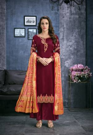 Grab This Designer Straight Suit In Maroon Color Paired With Maroon Colored Bottom And Contrasting Peach Colored Dupatta. Its Top Is Fabricated On Satin Georgette Paired With Santoon Bottom And Jacquard Silk Fabricated Dupatta. Its Top Is Beautified With Attractive Embroidery. Buy Now.