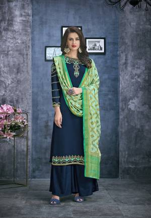 Enhance Your Personality Wearing This Designer Straight Suit In Navy Blue Color Paired With Contrasting Light Green Colored Dupatta. Its Top Is Fabricated On Satin Georgette Paired With Santoon Bottom And Jacquard Silk Fabricated Weaved Dupatta.