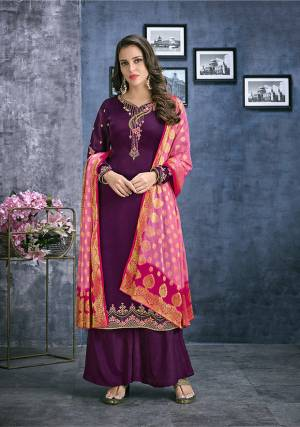 Add This Lovely Designer Straight Cut Suit To Your Wardrobe In Wine Color Paired With Contrastin Pink Colored Dupatta. Its Pretty Embroidered Top Is Fabricated On Satin Georgette Paired With Santoon Bottom And Jacquard Silk Fabricated Dupatta. Buy Now.