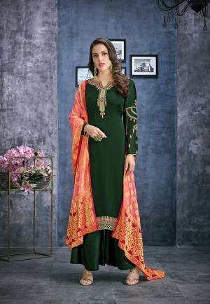 Celebrate This Festive Season Wearing This Designer Straight Cut Suit In Dark Green Color Paired With Contrasting Peach Colored Dupatta. Its Top Is Fabricated On Satin Georgette Paired With Santoon Bottom And Jacquard Silk Fabricated Dupatta. All Its Fabrics Ensures Superb Comfort All Day Long.