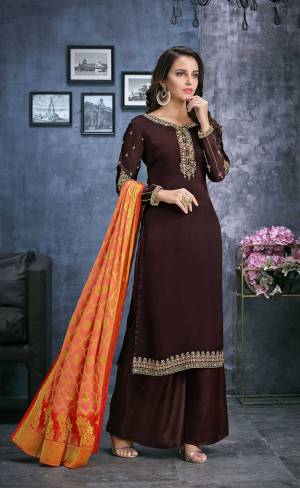 Enhance Your Personality Wearing This Designer Straight Suit In Brown Color Paired With Contrasting Orange Colored Dupatta. Its Top Is Fabricated On Satin Georgette Paired With Santoon Bottom And Jacquard Silk Fabricated Weaved Dupatta.