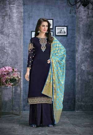 Go With The Shades Of Blue With This Designer Straight Plazzo Suit In Navy Blue Color Paired With Light Blue Colored Dupatta. Its Top Is Fabricated On Satin Georgette Paired With Santoon Bottom And Jacquard Silk Fabricated Dupatta.