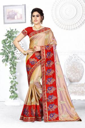 Here Is A Beautiful Designer Saree In Golden Color Paired With Contrasting Red Colored Blouse. This Saree And Blouse are Silk Based Beautified With Contrasting Embroidery Making It More Attractive. Buy This Designer Saree Now.