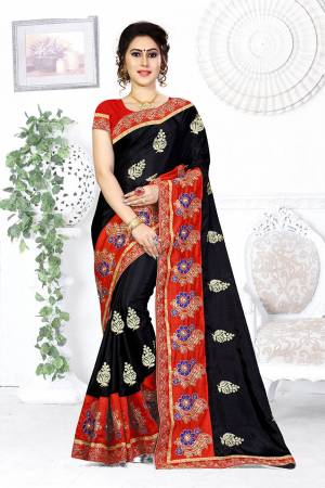 Here Is A Beautiful Designer Saree In Black Color Paired With Contrasting Red Colored Blouse. This Saree And Blouse are Silk Based Beautified With Contrasting Embroidery Making It More Attractive. Buy This Designer Saree Now.