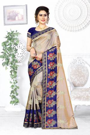 Look Pretty In This Designer Silver Colored Saree Paired With Contrasting Royal Blue Colored Blouse. This Saree And Blouse Are Silk Based Beautified With Attractive Embroidery. Buy This Designer Saree Now.