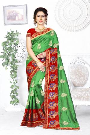 Here Is A Beautiful Designer Saree In Green Color Paired With Contrasting Red Colored Blouse. This Saree And Blouse are Silk Based Beautified With Contrasting Embroidery Making It More Attractive. Buy This Designer Saree Now.