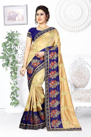 Here Is A Beautiful Designer Saree In Beige Color Paired With Contrasting Royal Blue Colored Blouse. This Saree And Blouse are Silk Based Beautified With Contrasting Embroidery Making It More Attractive. Buy This Designer Saree Now.