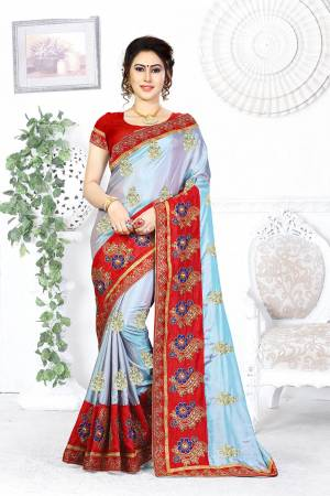 Look Pretty In This Designer Steel Blue Colored Saree Paired With Contrasting Red Colored Blouse. This Saree And Blouse Are Silk Based Beautified With Attractive Embroidery. Buy This Designer Saree Now.
