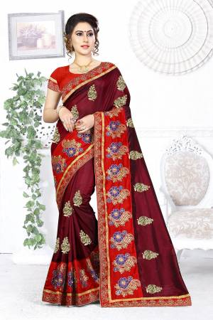 Here Is A Beautiful Designer Saree In Maroon Color Paired With Contrasting Red Colored Blouse. This Saree And Blouse are Silk Based Beautified With Contrasting Embroidery Making It More Attractive. Buy This Designer Saree Now.