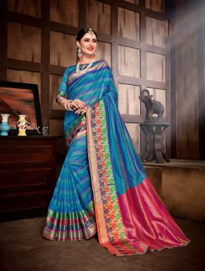 Grab This Designer Silk Based Saree In Blue Color Paired With Blue Colored Blouse. This Saree And Blouse are Fabricated On Banarasi Art Silk Beatified With Attractive Weave All Over. Buy Now.
