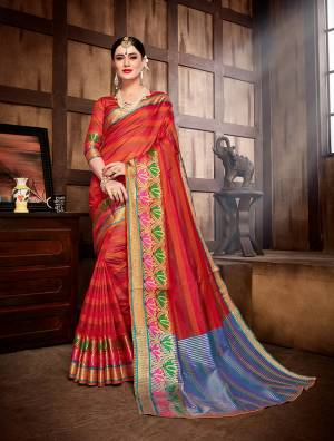 Celebrate This Festive Season With Ease And Comfort Wearing This Saree In Red Color Paired With Red Colored Blouse. This Saree And Blouse Are Fabricated On Banarasi Art Silk Beautified With Weave All Over.