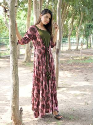 Get This Very Pretty Readymade Designer Kurti For Your Semi-Casuals. This Pretty Kurti Is Fabricated On Rayon Beautified With Prints All Over. It Is Available In All Regular Sizes. Buy Now.