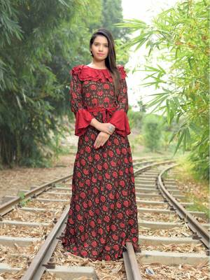 Add Some Lovely Kurtis To Your Wardrobe For This Summer With This Readymade Designer Kurti Fabricated On Rayon Beautified With Prints. It Is Light In Weight And Its Fabrics Ensures Superb Comfort All Day Long.