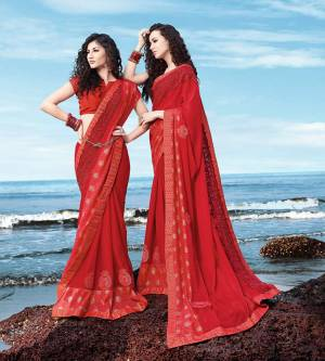 Adorn The Pretty Angelic Look Wearing This Designer Red Colored Saree Paired With Red Colored Blouse. This Saree Is Fabricated On Georgette Satin Paired With Art Silk Fabricated Blouse. It Is Beautified With Attractive Tone To Tone Embroidery.