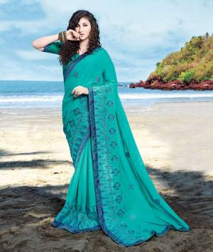 Beat The Heat This Summer Wearing This Designer Saree In Turquoise Blue Color Paired With Turquoise Blue Colored Blouse. This Saree Is Fabricated On Georgette Satin Paired With Art Silk Fabricated Blouse.