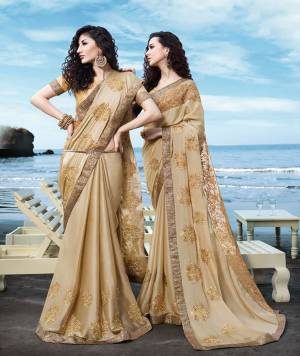 Flaunt Your Rich And Elegant Taste Wearing This Designer Saree In Beige Color Paired With Beige Colored Blouse. This Saree Is Fabricated On Georgette Satin Paired With Art Silk Fabricated Blouse. Its Rich Color And Embroidery Will Earn You Lots Of Compliments From Onlookers.