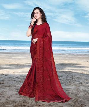 Here Is Royal Looking Designer Saree In Maroon Color Paired With Maroon Colored Blouse. This Saree Is Fabricated On Georgette Satin Paired With Art Silk Fabricated Blouse. Buy Now.