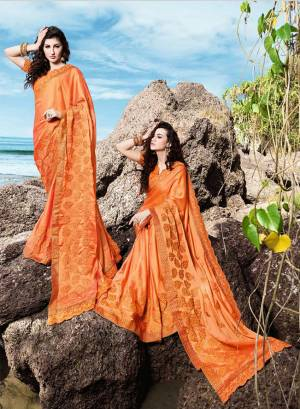 Celebrate This Festive Season Wearing This Designer Saree In Orange Color Paired With Orange Colored Blouse. This Saree Is Fabricated On Georgette Satin Paired With Art Silk Fabricated Blouse. Its Bright Color Will Give An Attractive Look To Your Personality.