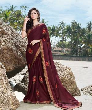 A Must Have Shade In Every Womens Wardrobe Is Here With This Designer Saree In Wine Color Paired With Brown Colored Blouse. This Saree Is Fabricated On Georgette Satin Paired With Art Silk Fabricated Blouse. Buy Now.