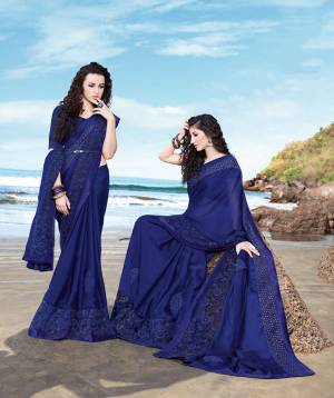 Bright And Visually Appealing Color Is Here With This Designer Saree In Royal Blue Color Paired With Royal Blue Colored Blouse. This Saree Georgette Based Saree Is Light Weight And Easy To Carry All Day Long.