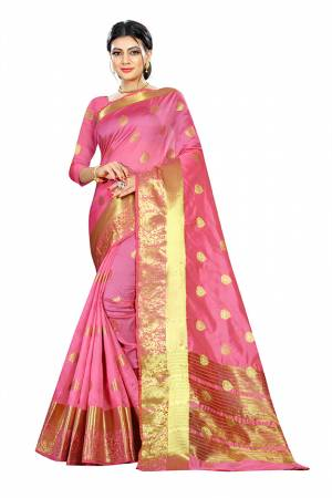 Beat This Heat This Summer Wearing This Pretty Attractive Pink Colored Saree. This Saree And Blouse Are Fabricated On Cotton Silk Beautified With Weave Butti All Over. Also It Is Light In Weight And Easy To Carry All Day Long.